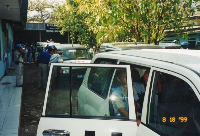 UN volunteers and vans at the Maliana UN base.